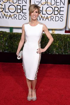 Felicity Huffman In Lorena Sarbu dress and Swarovski clutch.   Golden Globes 2015 - ELLE.com