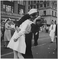 New York City celebrating the surrender of Japan. They threw anything and kissed anybody in Times Square. 08/14/1945  Victor Jorgenson, Photographer. From the General Photographic File of the Department of the Navy