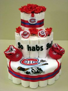 Now I need all of my hockey friends to have babies so I can make them New Jersey Devils instead Montreal Canadiens, Diaper Cake Boy, Diaper Cakes, Hockey Cakes, Chocolate Wrapping, Gateaux Cake, Gift Cake, Fancy Cakes, Baby Crafts
