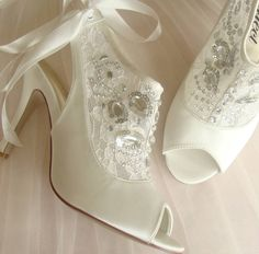 Daring to be differnt these are the perfect ivory lace bridal bootiesAvailable in ivory.We love the way these lace bridal booties are equally daring and darling. The ivory lace lends a romantic air, while the ankle-skimming silhouette makes them a fashion treat. Satin ribbon ankle tie fastening Peep toe design wedding shoes Luxury ivory satin With a cushioned inner sole to help give you all day comfort. Sizes UK 3 - 8.Upper, inner and sole are all synthetic.Heel height 9cm or 3.5 inches