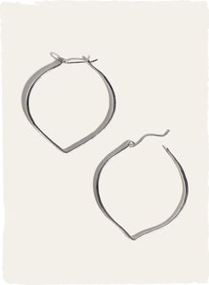 A sleek, modern and everyday wearable accessory, the hand-hammered sterling silver hoops.