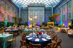 The evening featured a mix of rectangular and round tables with brightly colored linens. Projections ofmonkeys on the wall tied the room into the gala's theme.