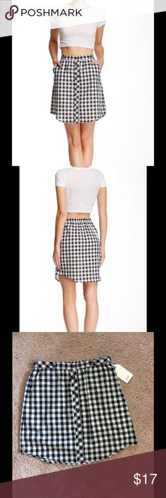 """$10 1 hour sale Jolt Black/White Skirt Jolt skirt that buttons down the front. Great to wear to date night or hanging with friends. 2 front pockets and banded waist. 18"""" length. 100 % cotton. Machine wash cold. Fits true to size. Jolt Skirts"""