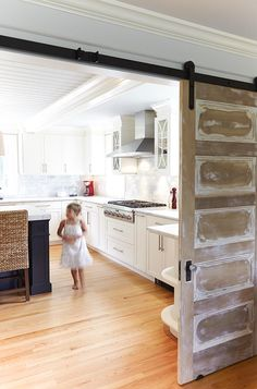 sliding door from Mudroom to Kitchen. I can use this to create a door for the basement.