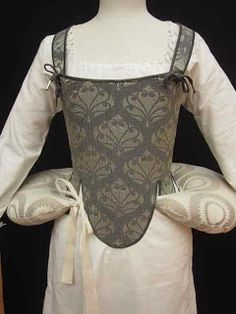 Bum roll: Padded roll placed around the waist in order to give skirts greater width below the waist.