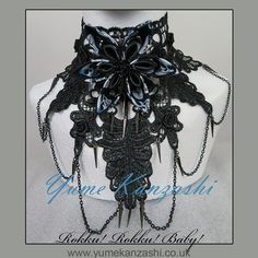 Rokku! Rokku! Baby!Introducing our new, more gothic styled pieces!Rokku! Rokku! Baby! choker is definitely a stand out piece!Made from Black lace, with a large skull print double layer Kanzashi flower adorning the front. 8 black roses are also delicately stitched to the lace. The front Kanzashi flower also features silver toned spikes in between the skull print petals, finished with a black resin rose centre. Silver