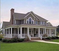 Exterior of a colonial style house. The wrap around porch is a great feature for the front of the house.