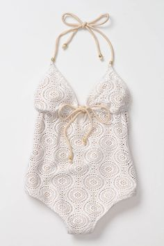 Crocheted halter suit. This is cute, but white swimsuits are never a good idea, so I've heard