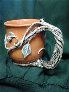 Thrown and altered clay mug blending terra cotta with white earthenware. Glazed clear, lead free, food safe. I REALLY wanna make this