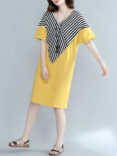 Specification: Sleeve Length:Half Sleeve Neckline:V-neck Color:Yellow,Black Style:Casual,Fashion Length:Knee-length Pattern:Stripe Material:Cottton,Polyester Season:Summer Package included: 1*Dress