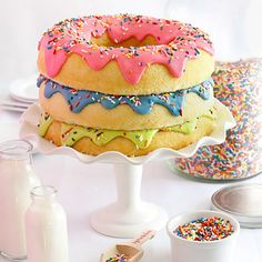 A cake that looks like a stack of giant doughnuts.