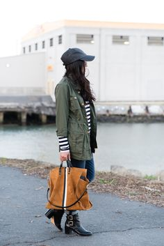 Pair a Gap striped tee with a versatile jacket for a casual fall day. Blogger The Fancy Pants Report adds black booties to the look for a bit of edge. Shop our comfortable long sleeve tees.