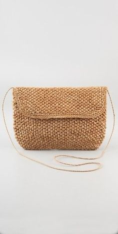 Grab and Go: 25 Clutches to Get You Seasonally Chic Just in Time For Summer: This metallic woven clutch would work just as well for a Summer wedding as it would for evening cocktails. Anya Hindmarch Rossum Woven Leather Clutch ($550) : The simplest kind of woven clutch still lends an easy Summer appeal to your outfits. Bop Basics Oversized Popcorn Clutch ($78)