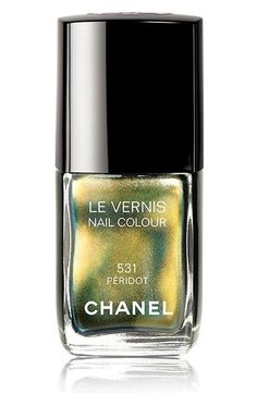 Chanel Fall 2011: Peridot Le Vernis. Did I mention that this shade is limited edition? It's greenish-gold, and at the edge of the nails, it will look slightly darker green and almost teal. Isn't it awesomee? <3