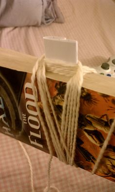 how to make an andean plying bracelet using a book and an index card by Yarn Nerd