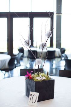 Modern black and white centerpieces with pops of color from paper cranes.