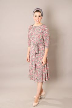 Long sleeve dress. Modest and chic, Beige dress with long sleeves and floral fabric print. Super comfortable and perfect for both casual and formal wear. This is a midi length dress, with loose cut just below the knee. Made with fine quality Viscose fabric, very soft and airy. #longsleevedress #modestdress #classicdress #mididress #holidaydress #floraldress #dresswithbelt #mormonfashion #apostolicfashion #tzniutfashion #tzniutstyle