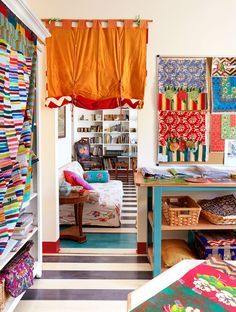 From vivid reds to yellows, purples, and blues, textile designer Lisa Corti has led a life surrounded by color. The threads converge in her bijou apartment, where the vibrant rooms hum with her creative spirit. #milanapartments #colorfulinteriors #elledecor Milan Apartment, Elle Decor, Textile Design, Colorful Interiors, Valance Curtains, Interior Decorating, Bed, Room, Inspiration