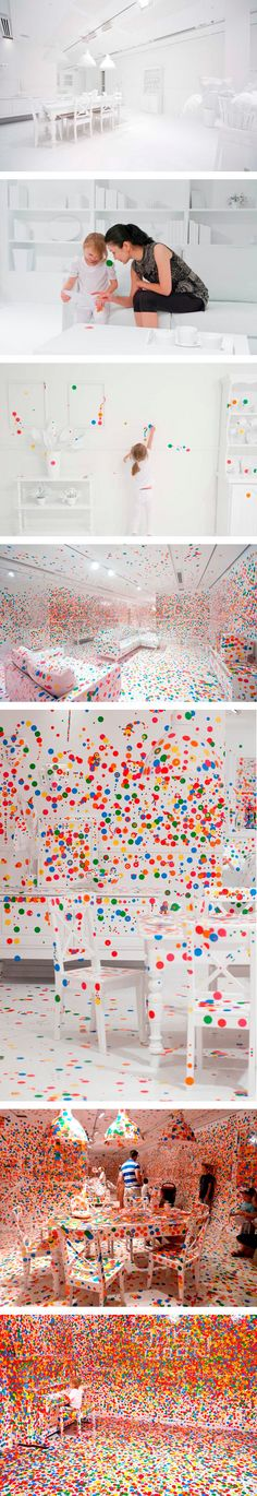 toddlers and an endless supply of stickers let loose in a totally white room .. I love this :)
