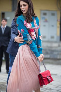 Blue embroiderd jumper with pink chiffon skirt and red handbag. #embroidered-jumper #chiffon-skirt