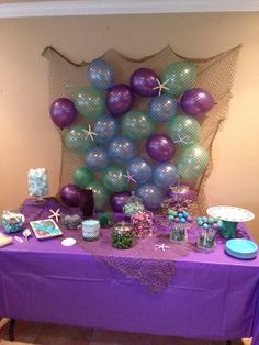 Such a creative backdrop at a Mermaid party! See more party ideas at CatchMyParty.com! #partyideas #mermaid