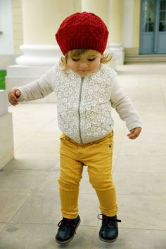 white lace front sweater, yellow and white polka dot skinny pant red knit cap and black shoes. http://makoweczki.pl/