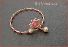 memory wire jewelry with a button focal