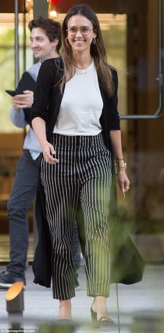 She means business! Jessica Alba cut a smart figure on Sunday, leaving her office building donning oversize glasses and pinstriped pants