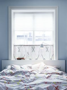 Enjoy both privacy and sunlight by placing a curtain on the lower half of the window.