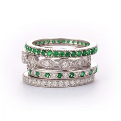 SusanB.flawless Simulated Diamond and Emerald Stackable Bands Set of 4 Rings Sterling Silver  Item # R1MXXX $99.00  Take high fashion to new heights with a stunning stack of gorgeous rings. This four-piece stack ring set features gleaming platinum-plated designs hand set with simulated diamonds and emeralds. Wear the rings together, separately, or one at a time for endless fashion possibilities.