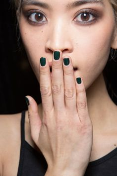 Katie Jane Hughes layered Butter London Nail Lacquer in Racing Green on top of Union Jack Black for a deep, forest green manicure.   - HarpersBAZAAR.com