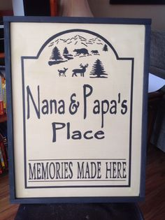 Nana and Papas place sign  with bears and deer on it.