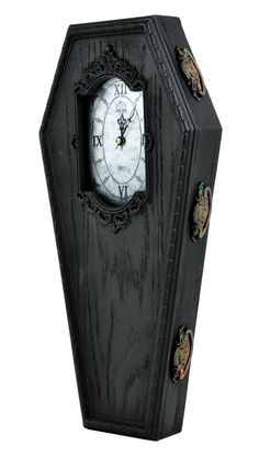 Manufactured in the USA by Winter's Asylum. These Original Coffin Clocks stand at 17 inches tall, 8 inches wide and 2 1/2 inches deep, these Coffin Clocks can be hung on a wall or displayed on a flat