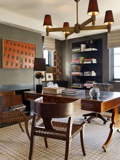 desk, houndstooth rug, klismos chair, chandelier, roman shades, styled bookshelves