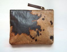 A N I M A L Hair on Hide Clutch. Leather Animal Clutch. Brown Leather Clutch. $90.00, via Etsy.