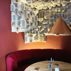 I created this wall for a Danish restaurant, about 100 folded books....and its great for noice pollution. www.lacarriere.dk