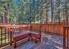 Step out of the hot tub onto the ground level deck and the into the fenced yard