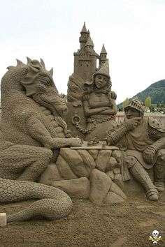 Sand sculpture, by Damon Farmer and Brad Goll, of a knight and dragon playing chess. ~ The detail of this sculpture is simply amazing to me. Beautiful and Entertaining!