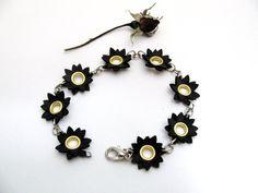 Upcycled inner tube flower bracelet. $13.00, via Etsy.