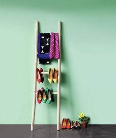 Ladders offer a rustic way to decoratively store the things that won't fit in your closet.