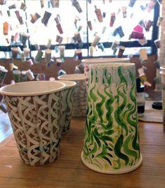 New brush drawings on Gwyneth Leech's used cups from coffee bars in Grand Rapids: Lantern, Madcap, Propaganda and Direct Trade Coffee Club. Vote Code: 56642.