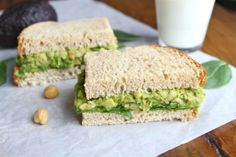 Chickpea and Avocado Sandwich ingredients: One can chickpeas or garbanzo beans, a large avocado, 1/4 cup fresh cilantro, two tablespoons chopped green onion, juice from 1 lime, salt and pepper, bread and spinach leaves.