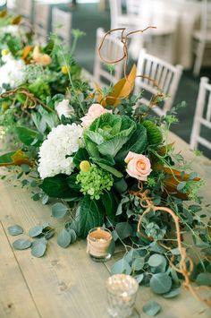 Loving flowers like we do, floral table runners are our idea of pure bliss! We love how they span the entire length of the table, how sometimes they hang to the floor, how they are low enough so you can actually see the person across from you…. and the list goes on. We've seen weddings …