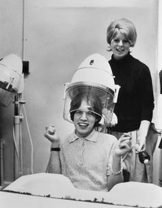 Mick Jagger under a hair dryer in 1964