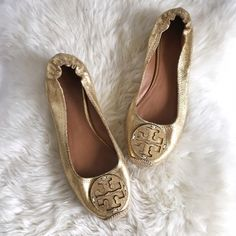 Gold Tory Burch Espadrille Flats The Tory Burch Reva style is given a sunny update with these TB espadrilles. They feature padded footbed, braided Espadrille details, and intentionally crackled gold finish. Brand new and never worn but has slight imperfections from being stored (see pics 2-4 for full details). NWOB so listed as new with tags. No trades please. Tory Burch Shoes Espadrilles