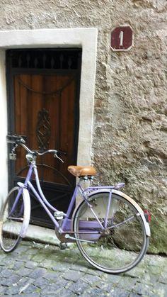 door and violet bicycle