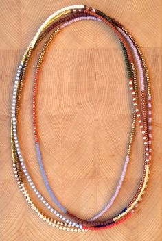 Long tribal seed bead necklaces set of 2 ! WWW.MAGGYCALHOUN.COM
