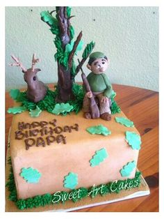 Smooth buttercream, hand crafted figures and tree, rolled fondant leaves.