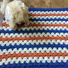 Handmade, by me, this afghan is perfect for your chilly pup. Can also be used as a doll blanket or lap afghan.  Measures: roughly 18.5 x 16 Colors: Blue, Carrot, Aran  Smoke-free, dog friendly home  Handmade in So Cal  Ready to ship! The one you see is the one you get.  Final picture is of a happy customer with her custom made afghan. She is a Rat Terrier/Chihuahua mix rescue. Do you want a custom color made just for you? Convo me