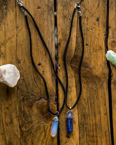 This listing is for a 2-pack of adjustable chokers featuring an Opalite, and a Lapis Lazuli Hexagonal Stone point pendant which hang from a…